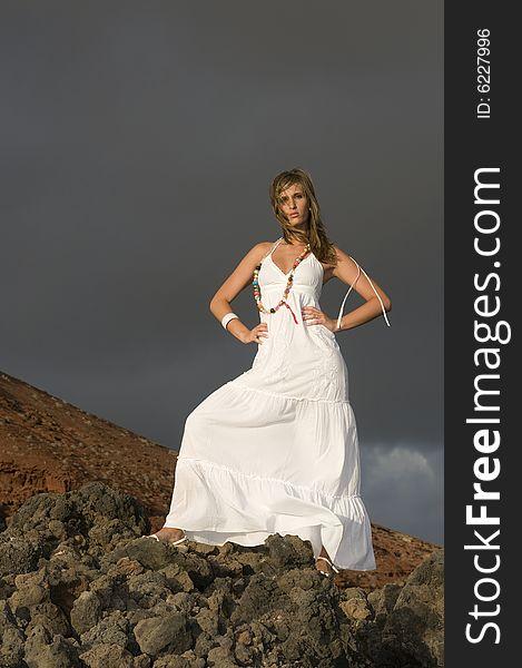 Beautiful model on the lava rocks of a vulcan