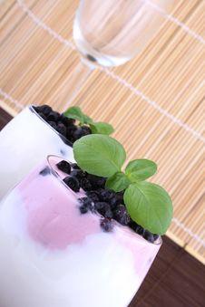 Blueberries In Yogurt Stock Images