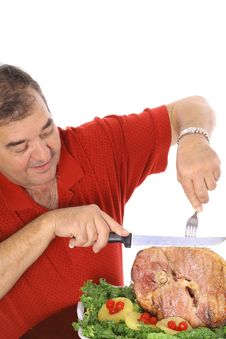 Free Grandfather Slicing A Ham Vertical Stock Photo - 6237370