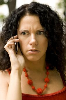 Woman On Phone Getting Bad News Stock Photo