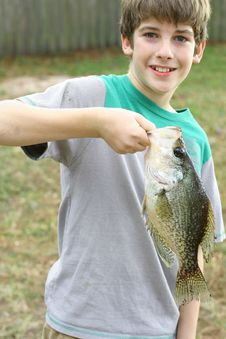 Free Young Boy Holding Fish He Caught Royalty Free Stock Images - 6239769