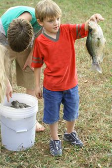 Free Young Boy Showing Off His Catch Stock Images - 6239774