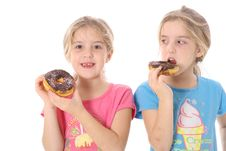Free Child Looking At Sister Eating A Doughnut Stock Photos - 6239873