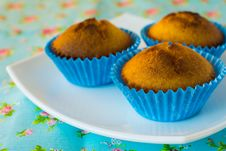 Muffins On Blue Background Royalty Free Stock Photos