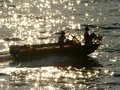Free Boat In The Reflections Of A Sun On Water Royalty Free Stock Photo - 6245135