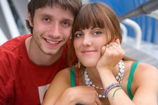 Teenage Couple Sitting Together And Smiling Royalty Free Stock Photography