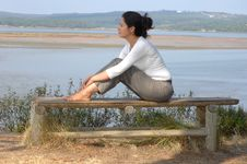 Free Woman Sitting On A Park Stock Photos - 6240473