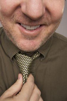 Free Smiling Man Fixing Tie Royalty Free Stock Photos - 6241098