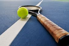 Free Tennis Ball And Racquet On A Court Line Stock Image - 6241591