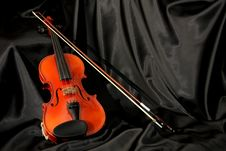Violin And Bow On Black Silk Royalty Free Stock Image