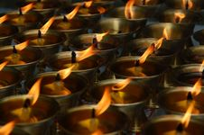 Many Burning Candles In Biddhist Church Stock Images