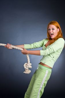 The Young Woman In A Sports Suit Pulls A Rope Stock Photos