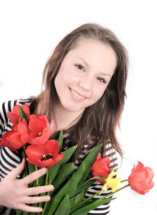 A Nice Girl With Red Tulips Royalty Free Stock Image