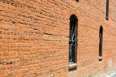 Old Brick And Iron Windows Royalty Free Stock Images