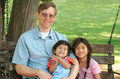 Free Father And Children Enjoying Swinging In The Park Royalty Free Stock Image - 6255646