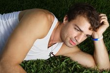 Free Young Man Laying On The Grass Stock Photos - 6250163