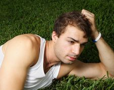 Free Young Man Laying On The Grass Royalty Free Stock Image - 6250166