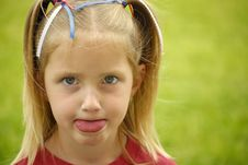 Free Little Girl Sticking Tounge Out Stock Photography - 6252732