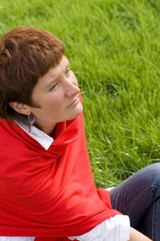 Woman Sitting On The Grass Royalty Free Stock Images