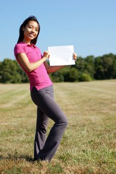 Free Girl With Blank Sign In Field Stock Photo - 6253720