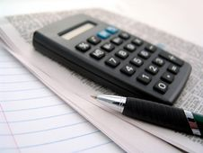 Free Newspaper, Calculator And Pen Royalty Free Stock Photography - 6254097