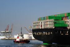 Tugboat And Back Of Container Ship Royalty Free Stock Image