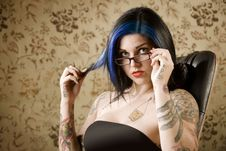 Free Pretty Woman With Tattoos In A Leather Chair Stock Photo - 6254980