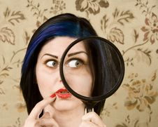 Free Pretty Woman With A Magnifying Glass Royalty Free Stock Image - 6255696