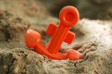 Toy Anchor In Sand Beach Stock Photography