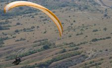 Orange Paraglider Above The Valley Royalty Free Stock Photos