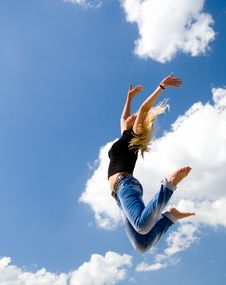 Free Pretty Girl Jumping On Blue Sky Background Royalty Free Stock Photo - 6258545