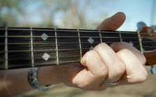 Free Hand Playing Guitar Stock Photography - 6259272
