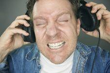 Free Shocked Man Wearing Headphones Stock Photo - 6263120