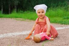 Small Girl Playing With A Doll Royalty Free Stock Images