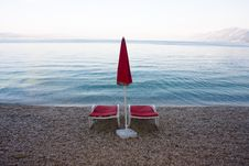 Free Chaises On The Empty Beach Stock Image - 6268091