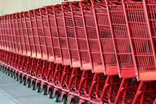Row Of Red Metal Shopping Carts Royalty Free Stock Image