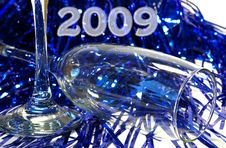 Free Champagne Goblet And A Dark Blue Tinsel Royalty Free Stock Photo - 6269555