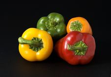 Red Yellow Orange And Green Peppers Stock Photos