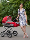 Free Woman With Baby Carriage Royalty Free Stock Photo - 6273475
