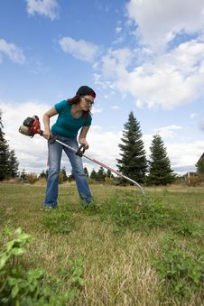 Free Woman With Weedwacker Stock Photo - 6275570