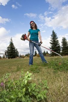 Free Woman With Weedwacker Stock Photography - 6275612