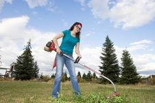 Free Woman With Weedwacker Stock Photos - 6275693