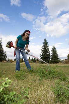Woman With Weedwacker Royalty Free Stock Photo