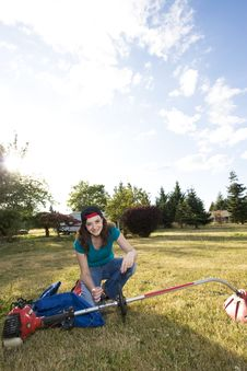 Free Woman With Weedwacker Stock Photo - 6275960