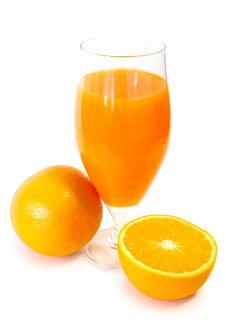 Orange Juice In Glass And Oranges. Stock Images