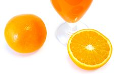 Orange Juice In Glass And Oranges. Stock Photography