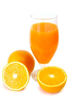 Orange Juice In Glass And Oranges. Royalty Free Stock Photos