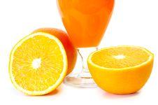 Orange Juice In Glass And Oranges. Stock Photo