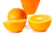 Orange Juice In Glass And Oranges. Stock Photos