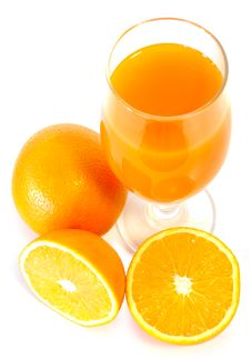 Orange Juice In Glass And Oranges. Royalty Free Stock Images